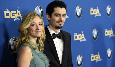 """Damien Chazelle, director of """"La La Land,"""" poses with his girlfriend Olivia Hamilton at the 69th annual Directors Guild of America Awards at the Beverly Hilton on Saturday, Feb. 4, 2017, in Beverly Hills, Calif. (Photo by Chris Pizzello/Invision/AP)"""