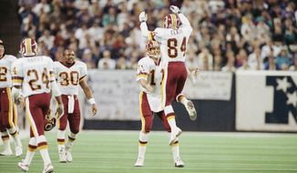 Washington Redskins Gary Clark (84) jumps into the arms of Mark Rypien after scoring a touchdown in Super Bowl XXVI at Minneapolis, on Jan. 31, 1992, against the Buffalo Bills.   (AP Photo/Jim Mone)