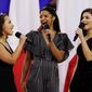 Singers of the cast of Hamilton, Phillipa Soo, right, Rene Elise Goldsberry, center, and Jasmine Cephas Jones, sing before the NFL Super Bowl 51 football game between the New England Patriots and the Atlanta Falcons, Sunday, Feb. 5, 2017, in Houston. (AP Photo/Matt Slocum)