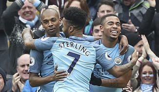 Manchester City's Gabriel Jesus, right, celebrates scoring his side's opening goal with teammates,  during the English  Premier League soccer match between Manchester City and Swansea, at the Etihad Stadium, in Manchester, England, Sunday Feb. 5, 2017. (Martin Rickett/PA via AP)