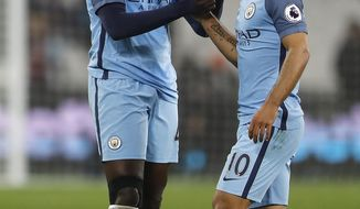 Manchester City's Yaya Toure, left, and Manchester City's Sergio Aguero celebrate after the English Premier League soccer match between West Ham and Manchester City at the London stadium, Wednesday, Feb. 1, 2017. Manchester City won the match 0-4. (AP Photo/Frank Augstein)