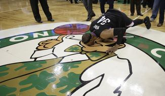 Los Angeles Clippers forward Paul Pierce (34) bends down to kiss the Boston Celtics logo following an NBA basketball game, Sunday, Feb. 5, 2017, in Boston. (AP Photo/Steven Senne)