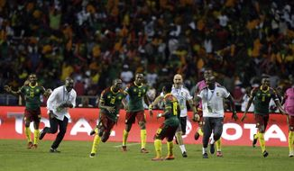 Cameroon players and staff celebrate after Vincent Aboubakar, 3rd left, scored their second goal during the African Cup of Nations final soccer match between Egypt and Cameroon at the Stade de l'Amitie, in Libreville, Gabon, Sunday, Feb. 5, 2017. (AP Photo/Sunday Alamba)
