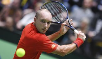 Belgium's  Steve Darcis returns a shot to Germany's Alexander Zverev, during their first round Davis Cup tennis match between Germany and Belgium in Frankfurt, Germany, Sunday, Feb. 5, 2017.  (Arne Dedert/dpa via AP)