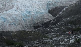 In this Aug. 4, 2012, file photo, tourists walk to Exit Glacier in Kenai Fjords National Park just outside Seward, Alaska. (AP Photo/Mark Thiessen) ** FILE **