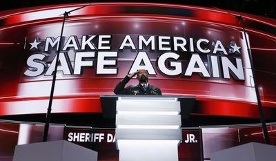 FILE - In this July 18, 2016, file photo, Milwaukee County Sheriff David Clarke salutes as he addresses the delegates during the opening day of the Republican National Convention in Cleveland. Clarke has risen to the national political spotlight with a brash, unapologetic personality reminiscent of President Donald Trump. But while some Republicans swoon over his prospects for higher office, the tough-talking, cowboy-hat wearing lawman remains one of the most polarizing figures in Wisconsin politics. (AP Photo/Carolyn Kaster, File)