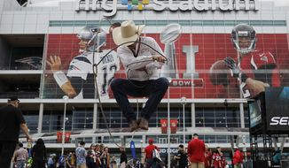 Joe Ward performs outside NRG Stadium before the NFL Super Bowl 51 football game between the New England Patriots and the Atlanta Falcons, Sunday, Feb. 5, 2017, in Houston. (AP Photo/Eric Gay)