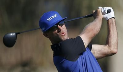 Graham DeLaet, of Canada, hits his tee shot at the second hole during the final round of the Waste Management Phoenix Open golf tournament Sunday, Feb. 5, 2017, in Scottsdale, Ariz. (AP Photo/Ross D. Franklin)