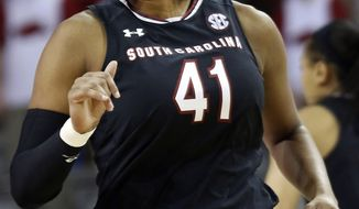South Carolina's Alaina Coates (41) runs back downcourt after scoring two points during the first half of an NCAA college basketball game against Arkansas, Sunday, Feb. 5, 2017, in Fayetteville, Ark. (AP Photo/Samantha Baker)