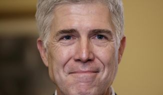 In this Feb. 1, 2017, photo, Supreme Court Justice nominee Neil Gorsuch pauses during a meeting on Capitol Hill in Washington. As a conservative student at Columbia University in the mid-1980s, Gorsuch was a political odd man out, and he was determined to speak up. (AP Photo/J. Scott Applewhite)