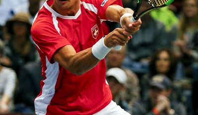 Switzerland's Henri Laaksonen returns the ball to United States' Jack Sock and Steve Johnson during a Davis Cup tennis match, Saturday, Feb. 4, 2017, in Birmingham, Ala. (AP Photo/Butch Dill)