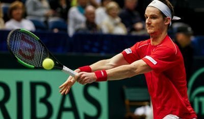 Switzerland's Adrien Bossel returns the ball to United States' Sam Querrey during a Davis Cup tennis match, Sunday, Feb. 5, 2017, in Birmingham, Ala. (AP Photo/Butch Dill)