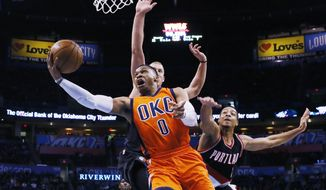 Oklahoma City Thunder guard Russell Westbrook (0) shoots in front of Portland Trail Blazers center Mason Plumlee, left, and guard C.J. McCollum (3) in the first quarter of an NBA basketball game in Oklahoma City, Sunday, Feb. 5, 2017. (AP Photo/Sue Ogrocki)