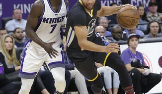 Golden State Warriors guard Stephen Curry, right, drives against Sacramento Kings guard Darren Collison during the first half of an NBA basketball game Saturday, Feb. 4, 2017, in Sacramento, Calif. (AP Photo/Rich Pedroncelli)