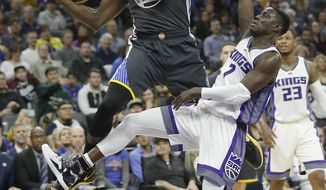 Golden State Warriors forward Draymond Green, left, is fouled by Sacramento Kings guard Darren Collison during the first half of an NBA basketball game Saturday, Feb. 4, 2017, in Sacramento, Calif. (AP Photo/Rich Pedroncelli)