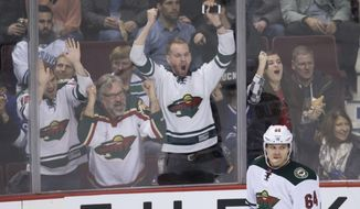 Fans celebrate after Minnesota Wild's Mikael Granlund, of Finland, scored his third goal against the Vancouver Canucks, during the third period of an NHL hockey game Saturday, Feb. 4, 2017, in Vancouver, British Columbia. (Darry Dyck/The Canadian Press via AP)