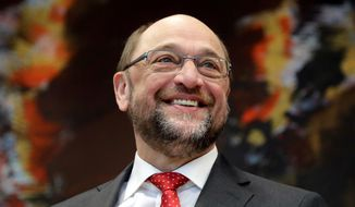 The designated chairman of the German Social Democratic Party, SPD, Martin Schulz, smiles as he arrives for a faction meeting of the German Social Democrats at the Reichstag building, host of the German federal parliament, Bundestag, in Berlin, Germany, Wednesday, Jan. 25, 2017. (AP Photo/Michael Sohn)