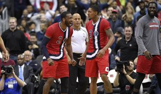 Washington Wizards guard John Wall (2) reacts with guard Bradley Beal, right, after Beal was fouled on a shot during the second half of an NBA basketball game, Tuesday, Jan. 24, 2017, in Washington. The Wizards won 123-108. (AP Photo/Nick Wass) **FILE**
