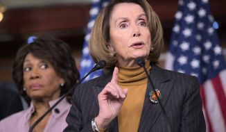 House Minority Leader Nancy Pelosi of Calif., joined by Rep. Maxine Waters, D-Calif., criticizes President Donald Trump's pro-Wall Street policies during a news conference on Capitol Hill in Washington, Monday, Feb. 6, 2017. (AP Photo/J. Scott Applewhite)