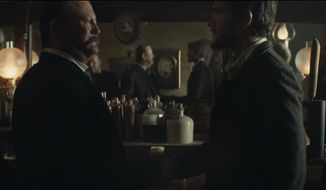 This photo provided by Budweiser shows a scene from the company's spot for Super Bowl 51. The scene depicts when Anheuser-Busch co-founder Adolphus Busch, right, after traveling by boat from Germany, met fellow immigrant Eberhard Anheuser. The New England Patriots defeated the Atlanta Falcons, 34-28, in overtime, in Super Bowl 51, on Sunday, Feb. 5, 2017. (Budweiser via AP)