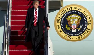 President Donald Trump walks down the steps of Air Force One upon his arrival at Andrews Air Force Base, Md., Monday, Feb. 6, 2017, returning from a weekend trip to Florida. (AP Photo/Jose Luis Magana)