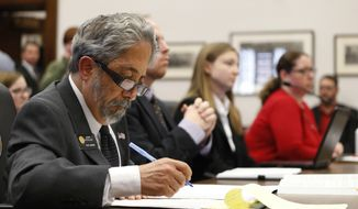 FILE - In this Feb. 24, 2016 file photo, Colorado State Sen. John Kefalas, D-Fort Collins takes notes as witnesses testify before a state Senate committee in support of an open records bill that he co-sponsored, in Denver. While Kefalas' bill died in a GOP-led Senate committee in 2016, a Democratic senator is trying again in 2017 to modernize Colorado's Open Records Act with a bill that would require government agencies to release public records in searchable data formats. (AP Photo/David Zalubowski, file)