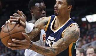 Utah Jazz guard George Hill (3) tries to shoot as Atlanta Hawks guard Dennis Schroder (17) defends in the first half of an NBA basketball game Monday, Feb. 6, 2017, in Atlanta. (AP Photo/John Bazemore)