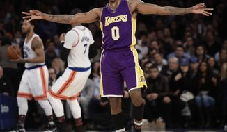 Los Angeles Lakers' Nick Young (0) celebrates after making a three-point basket during the second half of an NBA basketball game against the New York Knicks, Monday, Feb. 6, 2017, in New York. The Lakers won 121-107. (AP Photo/Frank Franklin II)