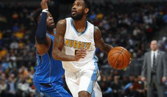 Denver Nuggets guard Will Barton, right, drives to the net past Dallas Mavericks guard Wesley Matthews in the second half of an NBA basketball game, Monday, Feb. 6, 2017, in Denver. The Nuggets won 110-87. (AP Photo/David Zalubowski)