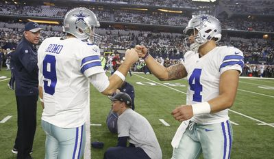 FILE - In this Jan. 15, 2017, file photo, Dallas Cowboys' Tony Romo talks to Dak Prescott before an NFL divisional playoff football game against the Green Bay Packers Sunday, Jan. 15, 2017, in Arlington, Texas. Now that NFL Offensive Rookie of the Year Prescott is entrenched as the starting quarterback for the Cowboys, it will be fascinating to see what happens with his predecessor, Romo. (AP Photo/Michael Ainsworth, File)