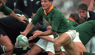 FILE - In this Saturday, June 24, 1995 file photo, South Africa's scrumhalf Joost van der Westhuizen lets fly a pass during the World Cup final against New Zealand at Ellis Park in Johannesburg. Joost van der Westhuizen, who won the 1995 World Cup with South Africa as Nelson Mandela looked on, has died after a six-year-battle with motor neuron disease. He was 45. South Africa Rugby announced the death Monday, Feb. 6, 2017.  (AP Photo/John Parkin, file)