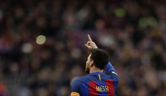 FC Barcelona's Lionel Messi celebrates after scoring during the Spanish La Liga soccer match between FC Barcelona and Athletic Bilbao at the Camp Nou in Barcelona, Spain, Saturday, Feb. 4, 2017. (AP Photo/Manu Fernandez)