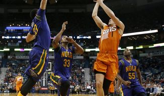 Phoenix Suns guard Devin Booker (1) shoots against New Orleans Pelicans forward Anthony Davis (23) in the first half of an NBA basketball game in New Orleans, Monday, Feb. 6, 2017. (AP Photo/Gerald Herbert)