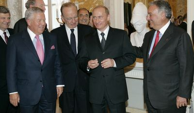 FILE - In this  June 25, 2005, file photo, Russian President Vladimir Putin, second right, holds the diamond-encrusted 2005 Super Bowl ring belonging to New England Patriots owner Robert Kraft, left , as News Corp. Chairman Rupert Murdoch, second left, and Citigroup Chairman Sanford Weill look on during a meeting of American business executives at the 18th century Konstantin Palace outside St. Petersburg, Russia. Kraft won his fifth Super Bowl ring on Feb. 5, 2017, but his third ring remains with Putin. (AP Photo/Alexander Zemlianichenko, File)