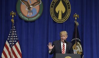 President Donald Trump speaks to troops while visiting U.S. Central Command and U.S. Special Operations Command at MacDill Air Force Base in Tampa, Fla., Monday, Feb. 6, 2017. (AP Photo/Susan Walsh)