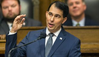 Wisconsin Gov. Scott Walker delivers his state of the state address to a joint session of the Legislature in Madison on Jan. 10, 2017. (Associated Press) **FILE**