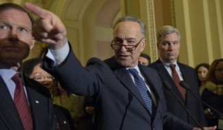 Senate Minority Leader Sen. Charles Schumer of N.Y., center, flanked by Sen. Richard Blumenthal, D-Conn., left, and Sen. Sheldon Whitehouse, D-R.I., calls on a reporter during a news conference on Capitol Hill in Washington, Tuesday, Feb. 7, 2017.  (AP Photo/Susan Walsh)