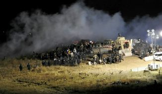 FILE - In this Nov. 20, 2016, file photo, provided by the Morton County Sheriff's Department, law enforcement and protesters clash near the site of the Dakota Access pipeline in Cannon Ball, N.D. A federal judge said Tuesday, Feb. 7, 2017, pipeline opponents involved in the violent clash with police are unlikely to succeed in a lawsuit alleging excessive force and civil rights violations. (Morton County Sheriff's Department via AP, File)