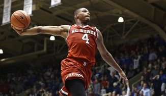 FILE - In this Jan. 23, 2017 file photo, North Carolina State's Dennis Smith Jr. (4) drives to the basket as time expires in the second half of an NCAA college basketball game against Duke in Durham, N.C. Two of the top freshmen in the Atlantic Coast Conference square off on Wednesday, Feb. 8 when Florida State's Johnathan Isaac faces N.C. State's Smith.  Eight freshmen are averaging 10 or more points per game, which could make balloting for the All-Freshman Team interesting. (AP Photo/Gerry Broome, File)