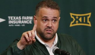 """In this Feb. 1, 2017 file photo, Baylor head football coach Matt Rhule talks with reporters at a NCAA college news conference during national signing day in Waco, Texas.  Brandon Washington was fired Saturday, Feb. 4 after school officials learned that he had been arrested earlier in the day on a Class B misdemeanor punishable by up to 180 days in a jail and a $2,000 fine. """"When we arrived at Baylor, we made a commitment to character and integrity in our program,"""" Rhule said. """"Brandon's actions are completely unacceptable. We will not tolerate conduct that is contradictory to these values."""" (Rod Aydelotte/Waco Tribune-Herald via AP)"""