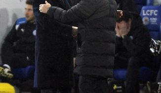 Manchester United manager Jose Mourinho, right, shakes hands with Leicester manager Claudio Ranieri after the final whistle during the English Premier League soccer match between Leicester City and Manchester United at the King Power Stadium in Leicester, England, Sunday, Feb. 5, 2017. Manchester United won the match 0-3. (AP Photo/Rui Vieira)