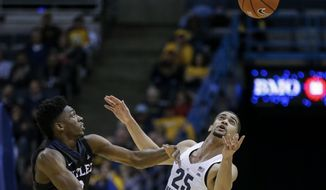 Marquette's Haanif Cheatham, right, makes a steal against Butler's Kamar Baldwin during the first half of an NCAA college basketball game Tuesday, Feb. 7, 2017, in Milwaukee. (AP Photo/Tom Lynn)