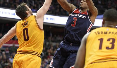 Washington Wizards guard Bradley Beal (3) shoots against Cleveland Cavaliers forward Kevin Love (0) during the overtime of an NBA basketball game, Monday, Feb. 6, 2017, in Washington. Also seen is Cleveland Cavaliers center Tristan Thompson (13), of Canada. The Cavaliers won 140-135 in overtime. (AP Photo/Nick Wass)