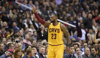 Cleveland Cavaliers forward LeBron James (23) gestures after he scored a basket during the second half of an NBA basketball game against the Washington Wizards, Monday, Feb. 6, 2017, in Washington. The Cavaliers won 140-135 in overtime. (AP Photo/Nick Wass)