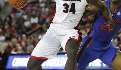 Georgia guard Juwan Parker (34) works against Florida forward Keith Stone (25) during the first half of an NCAA college basketball game Tuesday, Feb. 7, 2017, in Athens, Ga. (AP Photo/John Bazemore)