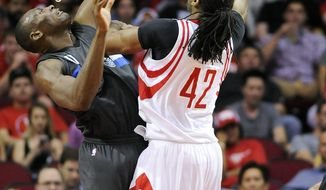 Houston Rockets center Nene Hilario (42) shots over Orlando Magic center Bismack Biyombo (11) in the first half of an NBA basketball game, Tuesday, Feb. 7, 2017, in Houston. (AP Photo/Eric Christian Smith)