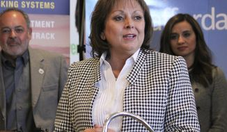 """FILE - This Feb. 1, 2017 file photo New Mexico Gov. Susana Martinez talks about the economic impact of a $37 million contract to install solar panels to power Facebook's new data center during a news conference in Albuquerque, N.M. The nation's only Latina governor is denouncing a charge by a white former mayor of Santa Fe that she is a racist. A spokesman for Martinez says comments made by former Santa Fe Mayor David Coss at an immigrant rights rally Monday, Feb. 6,  were """"are sad and ignorant."""" (AP Photo/Susan Montoya Bryan,File)"""