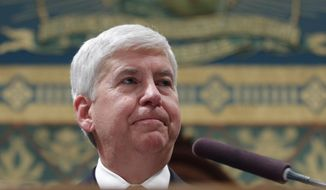 FILE - In this Jan. 17, 2017, file photo, Michigan Gov. Rick Snyder delivers his State of the State address to a joint session of Legislature at the Capitol in Lansing, Mich. Snyder is scheduled to unveil his budget plan Wednesday, Feb. 8, 2017. (AP Photo/Al Goldis, File)