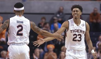 Auburn guard TJ Lang (23) celebrates a 3-point shot against Mississippi State with guard Bryce Brown (2) during an NCAA college basketball game Tuesday, Feb. 7, 2017, in Auburn, Ala. (Julie Bennett /AL.com via AP)