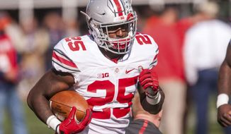 FILE - In this Nov. 14, 2015, file photo, Ohio State running back Bri'onte Dunn (25) warms up before an NCAA college football game against Illinois at Memorial Stadium in Champaign, Ill.   Dunn was sentenced Monday, Feb. 6, 2017,  in municipal court in Columbus. A domestic violence charge was dismissed under the plea arrangement, and he was ordered to stay away from the woman while on probation.  (AP Photo/Bradley Leeb, File)